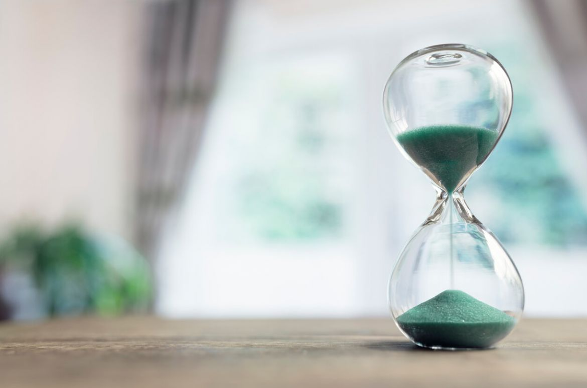 Hourglass on blurred background