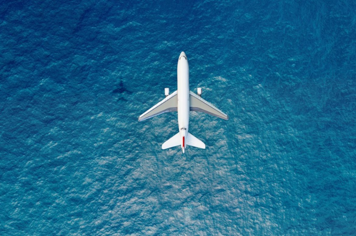 Airplane flies over sea view from above 1