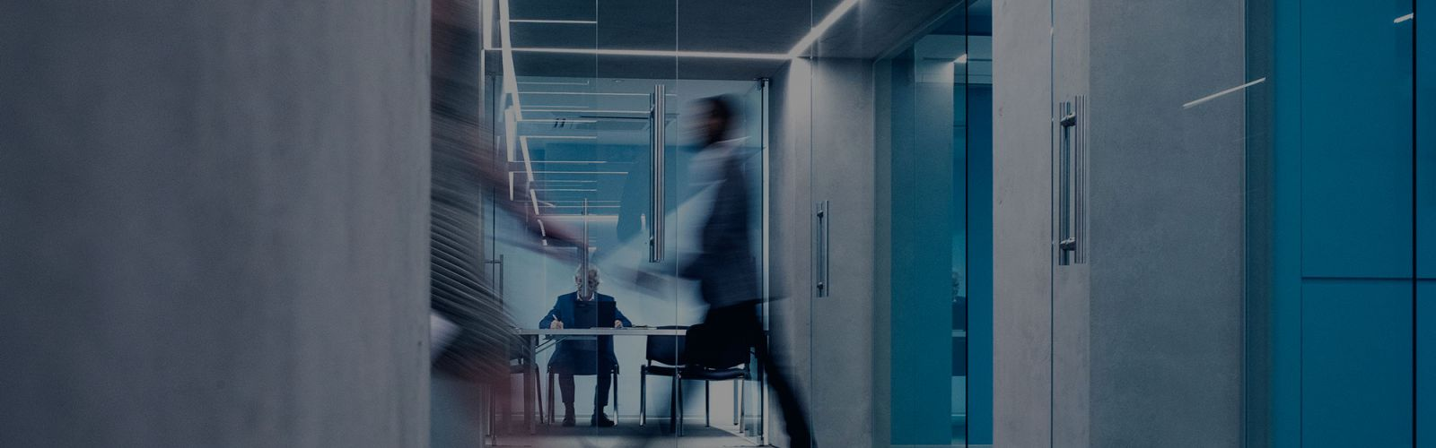Blurred people walking in office tax governance