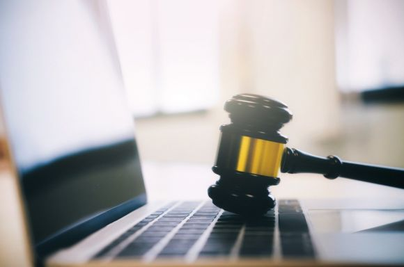 Gavel with laptop gold