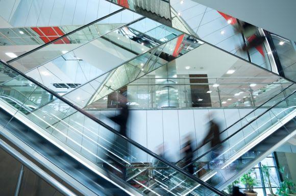 People on escalators at shopping mall v2