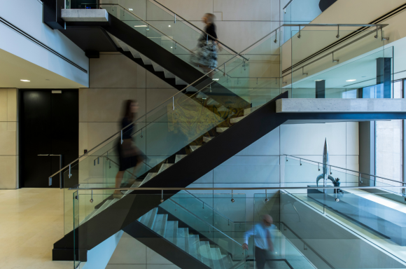 People walking on ABL Melbourne office staircase
