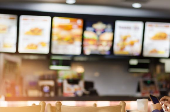 blur image of fast food restaurant use for defocused background picture id1145578527 1