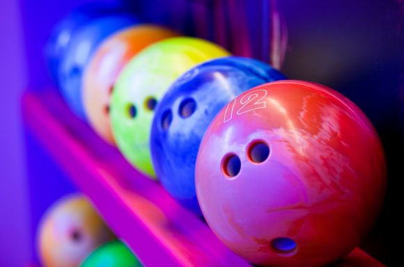 bowling balls on ball shelves picture id157678057
