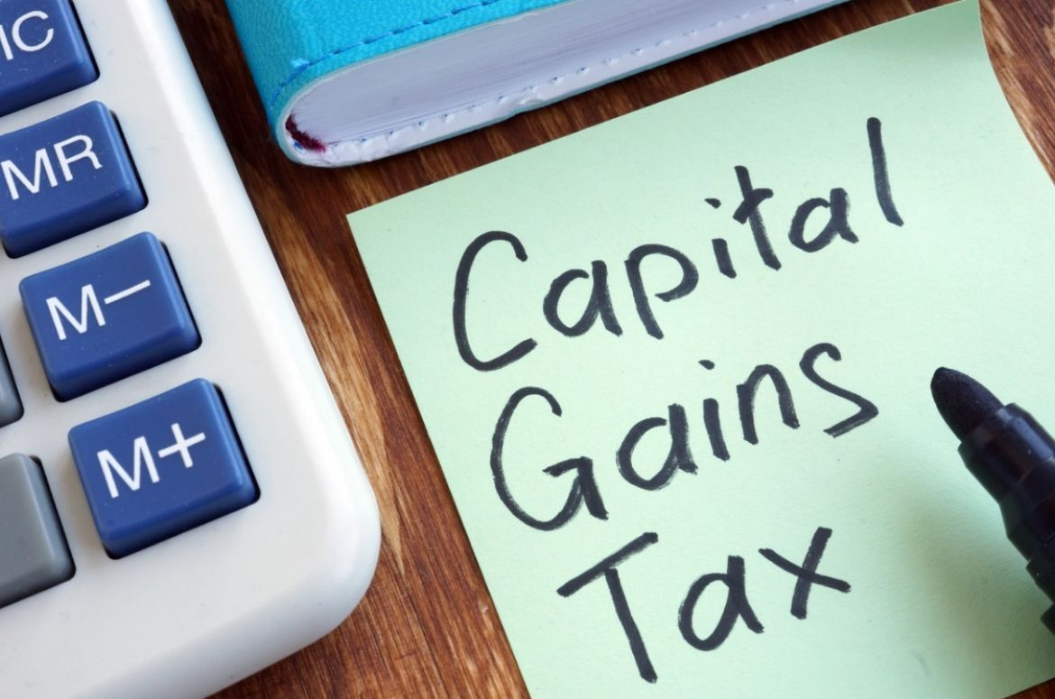 capital gains tax memo stick and calculator picture id1097299068